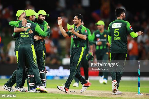 Pakistan celebrate after winning game three of the International Twenty20 match between New Zealand and Pakistan at Bay Oval on January 28 2018 in...