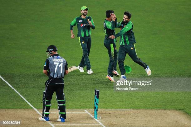 Pakistan celebrate as Colin de Grandhomme of the Black Caps is stumped during the International Twenty20 match between New Zealand and Pakistan at...