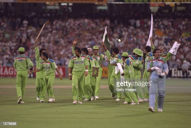 Pakistan celebrate as they take the last England wicket that of Richard Illingworth and win the Cricket World Cup at the MCG in Melbourne