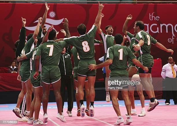 Pakistan celebrates after winning their their Men's Kabaddi Round Robin Match Five against Bangladesh at the 15th Asian Games Doha 2006 at Aspire...