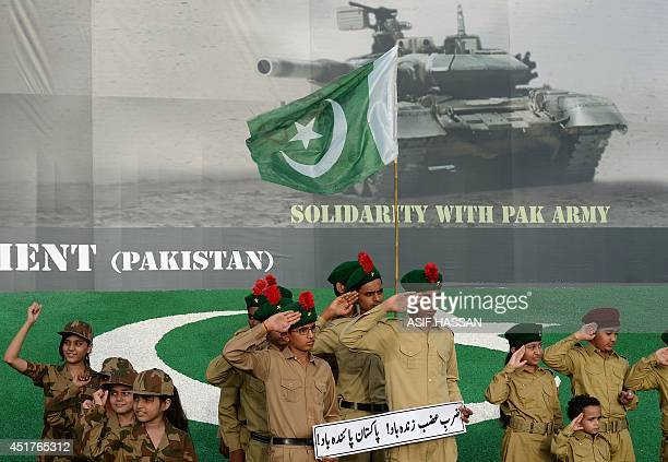 Pakistan children perform in army uniform during a Muttahidda Qaumi Movement rally in solidarity with the Army in Karachi on July 6 2014 The rally...