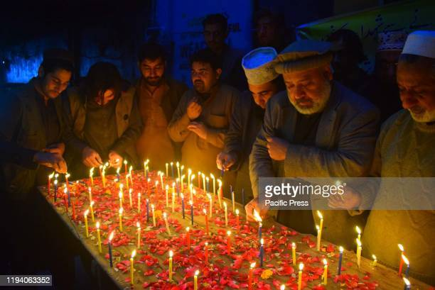 Pakistan civil society members holding a candle vigil for those killed in Neelum valley avalanche tragedy