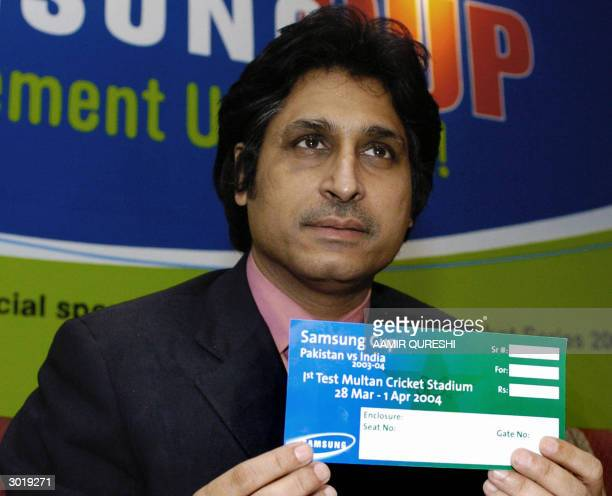 Pakistan Cricket Board Chief Executive Ramiz Raja shows a specimen of a ticket for next month's cricket series between Pakistan and India at a press...