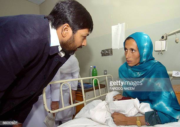 Pakistan cricket captain Inzamamul Haq talks with the mother of an injured earthquake survivor at the Pakistan Institute of Medical Science hospital...