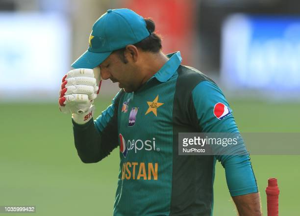 Pakistan cricket captain Sarfraz Ahmed walks back following his dismissal during the 5th cricket match of Asia Cup 2018 between India and Pakistan at...