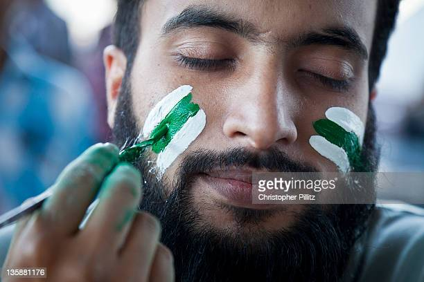 Pakistan - Cricket fan has face painted.
