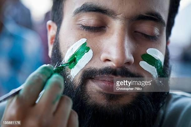 Pakistan - Cricket fan has face painted.