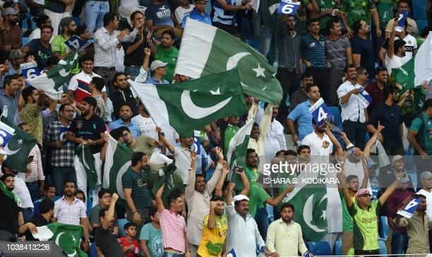Pakistan cricket fans cheer in support of their national team during the one day international Asia Cup cricket match between Pakistan and India at...