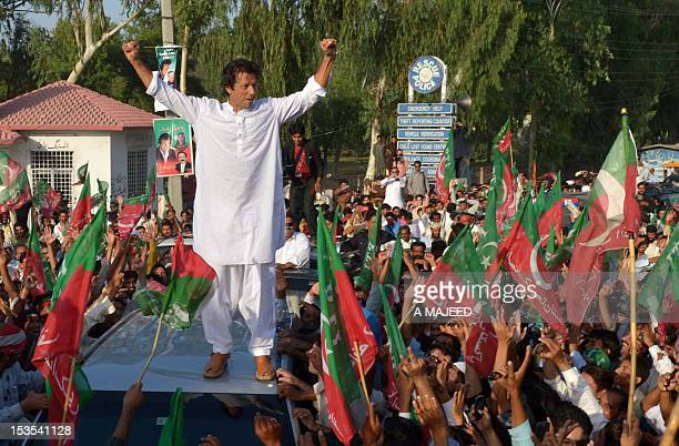 Pakistan cricket star turned politician Imran Khan gestures as he stands on a vehicle during a rally in Mianwali northern Pakistan on October 6 2012...