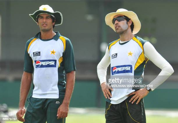 Pakistan cricketer Abdur Rauf and teammate Umar Gul take part in a practice session at the P Saravanamuttu Stadium in Colombo on July 11 2009 Sri...