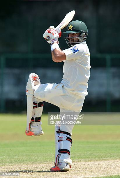 Pakistan cricketer Ahmed Shehzad plays a shot during the first day of the three day warm-up match between Sri Lanka Board President's XI and Pakistan...