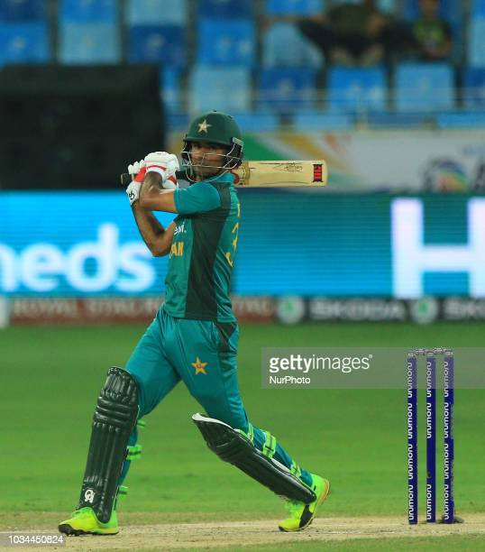 Pakistan cricketer Fakhar Zaman plays a shot during the 2nd cricket match of Asia Cup 2018 between Pakistan and Hong Kong in Dubai United Arab...