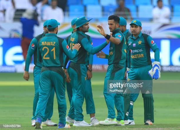 Pakistan cricketer Hasan Ali celebrates with his team members after taking a wicket during the 2nd cricket match of Asia Cup 2018 between Pakistan...