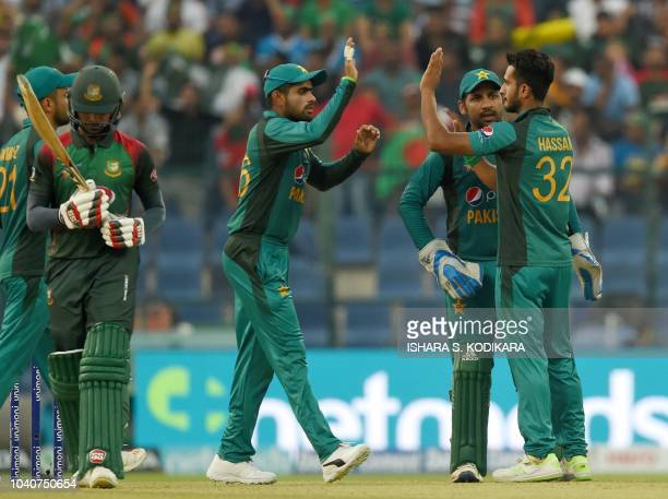 Pakistan cricketer Hasan Ali celebrates with teammates after he dismissed Bangladesh batsman Mohammad Mithun during the one day international Asia...