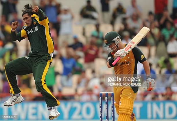 Pakistan cricketer Mohammad Aamer celebrates the wicket of Australian cricketer David Warner during the ICC World Twenty20 second semifinal match...