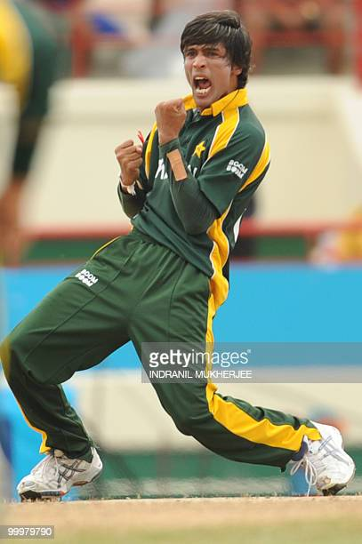 Pakistan cricketer Mohammad Aamer celebrates the wicket of Australian cricketer Shane Watson during the ICC World Twenty20 second semifinal match...