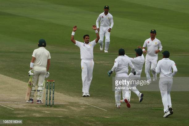 Pakistan cricketer Mohammad Abbas celebrates after dismissing Australian cricketer Marnus Labuschagne during day four of the second Test cricket...