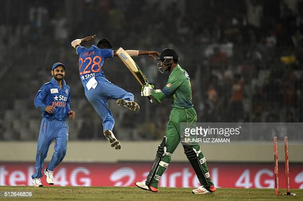 Pakistan cricketer Mohammad Amir walks off the field after being dismissied by Indian cricketer Hardik Pandya during the match between India and...