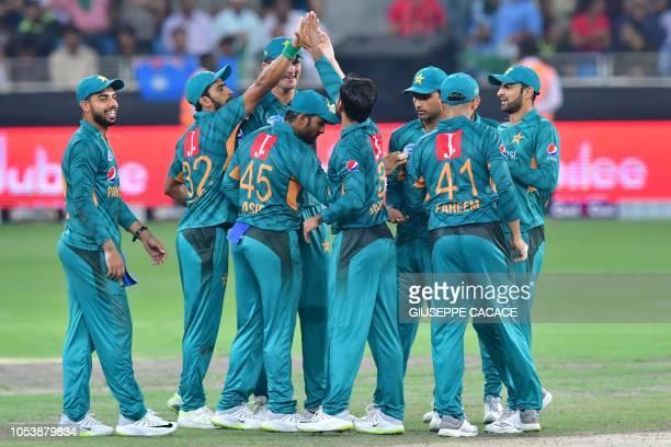 Pakistan cricketer Muhammad Hafez celebrates after he dismissed unseen Australian cricketer Alex Carey during the second T20 cricket match between...