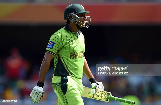 Pakistan cricketer Nasir Jamshed walks back after being dismissed by Zimbabwe during the 2015 Cricket World Cup Pool B match between Pakistan and...