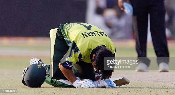 Pakistan cricketer Salman Butt bows down to touch the pitch after he scored a century during the third Oneday International match against India at...