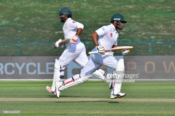 Pakistan cricketer Sarfraz Ahmed and Pakistan cricketer Babar Azam run between the wickets during day three of the second Test cricket match in the...