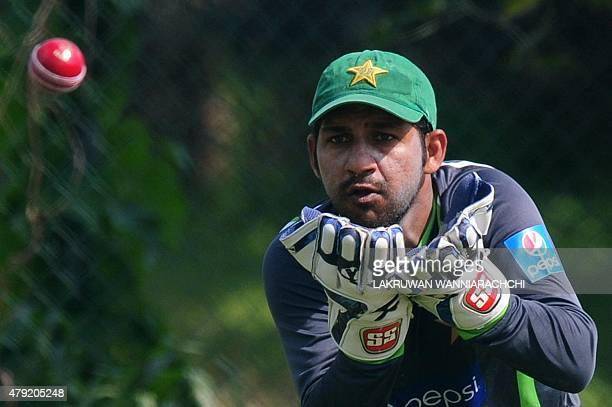 Pakistan cricketer Sarfraz Ahmed catches a ball during a practice session at the Pallekele International Cricket Stadium in Pallekele on July 2 2015...