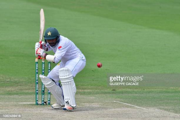 Pakistan cricketer Sarfraz Ahmed plays a shot during day three of the second Test cricket match in the series between Australia and Pakistan at the...