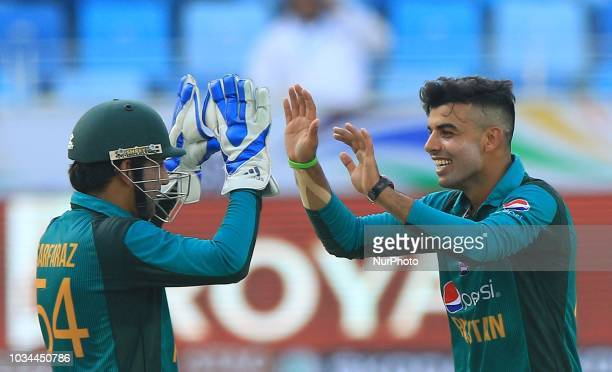 Pakistan cricketer Shadab Khan celebrates with captain Sarfraz Ahmed during the 2nd cricket match of Asia Cup 2018 between Pakistan and Hong Kong in...