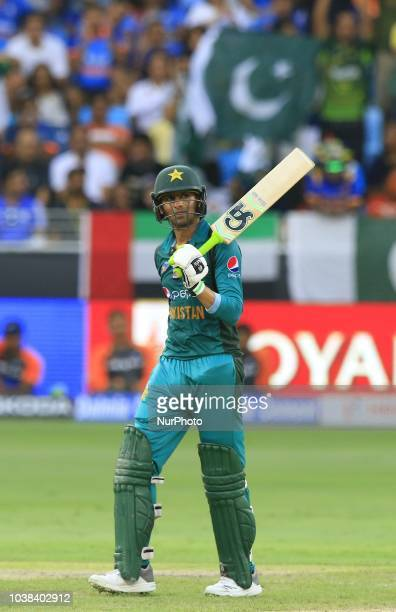 Pakistan cricketer Shoaib Malik celebrates after scoring 50 runs during the Asia Cup 2018 cricket match between India and Pakistan at Dubai...
