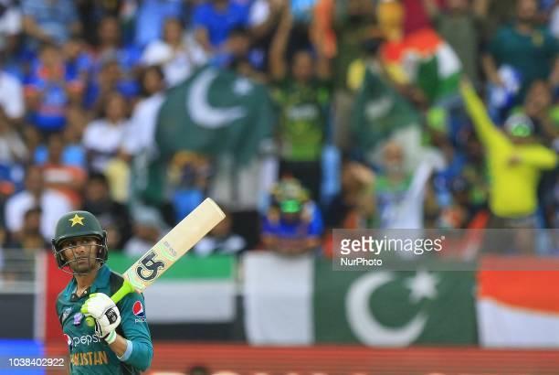 Pakistan cricketer Shoaib Malik celebrates after scoring 50 runs during the Asia Cup 2018 cricket match between India and Pakistan at Dubai...
