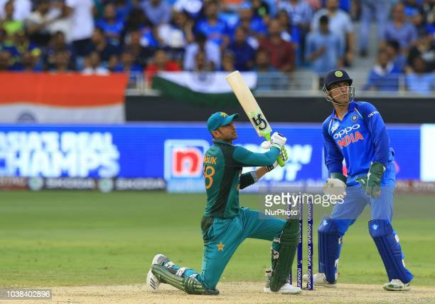 Indian cricket captain Rohit Sharma celebrates after scoring 100 runs during the Asia Cup 2018 cricket match between India and Pakistan at Dubai...