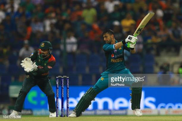 Pakistan cricketer Shoaib Malik plays a shot during the Asia Cup 2018 cricket match between Bangladesh and Pakistan at the Sheikh Zayed StadiumAbu...