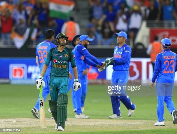 Pakistan cricketer Shoaib Malik walk back after his dismissal during the cricket match between India and Pakistan at Dubai International cricket...