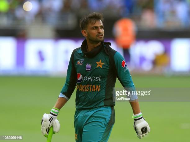 Pakistan cricketer Shoaib Malik walks back following his dismissal during the 5th cricket match of Asia Cup 2018 between India and Pakistan at Dubai...