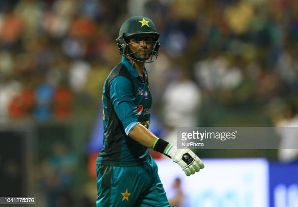 Pakistan cricketer Shoaib Malik walks back following his dismissal during the Asia Cup 2018 cricket match between Bangladesh and Pakistan at the...