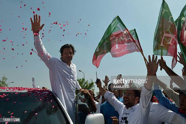 Pakistan cricketer turned politician Imran Khan waves to supporters at the start of a rally on the outskirts of Islamabad on October 6 2012 Khan is...