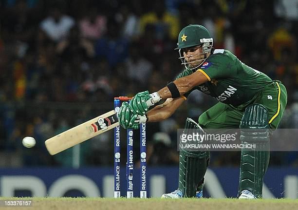 Pakistan cricketer Umar Akmal plays a shot during the ICC Twenty20 Cricket World Cup's semifinal match between Sri Lanka and Pakistan at the R...