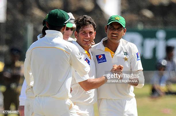 Pakistan cricketer Yasir Shah and teammates celebrate the dismissal of Sri Lankan cricketer Dinesh Chandimal during the final day of the opening Test...