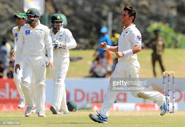 Pakistan cricketer Yasir Shah celebrates the dismissal of Sri Lankan cricketer Rangana Herath during the final day of the opening Test match between...