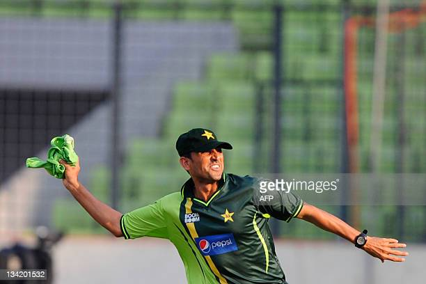 Pakistan cricketer Younis Khan throws a jersey during a team training session at the ShereBangla National Cricket Stadium in Dhaka on November 28...