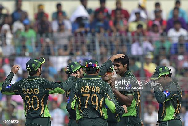 Pakistan cricketers congratulate teammate Rahat Ali after the dismissal of the Bangladesh cricketer Mohammad Mahmudullah during the first one day...