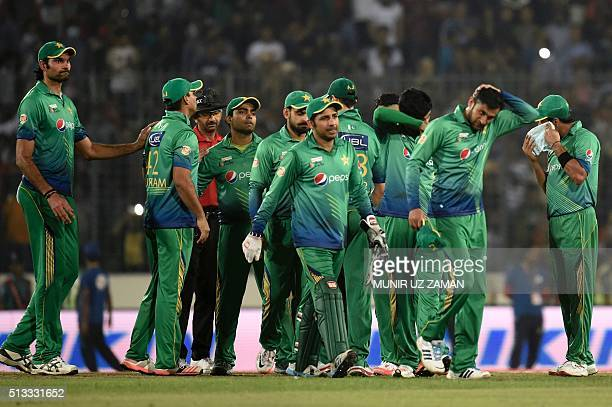 Pakistan cricketers leave the field after losing the Asia Cup T20 cricket tournament match between Bangladesh and Pakistan at the ShereBangla...