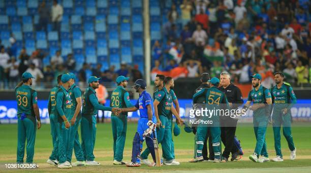 Pakistan cricketers shake hands with DInesh Karthik and Ambati Rayudu after the 5th cricket match of Asia Cup 2018 between India and Pakistan at...