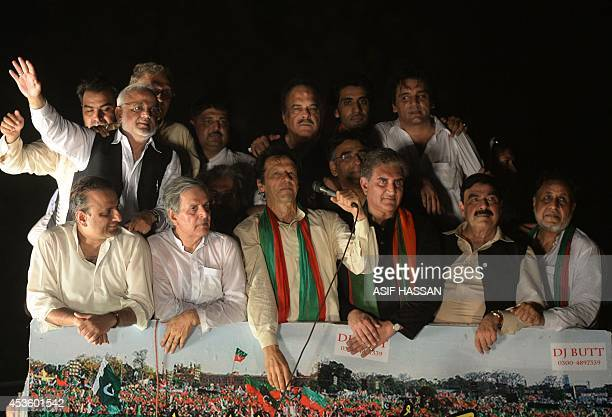 Pakistan cricketerturnedpolitician Imran Khan addresses supporters as he heads a protest march from Lahore to Islamabad against the government in...