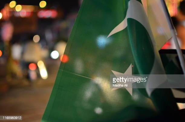 pakistan day independence or national day celebrations on the city streets, where crowd is motivated to join the parade and cheering with pakistan flags. - pakistan stock pictures, royalty-free photos & images