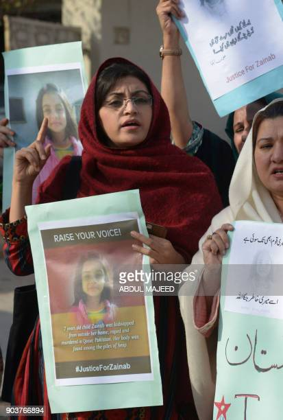 Pakistan demonstraters carry placards during a protest against rape and murder of a child in Peshawar on January 11 2018 At least two people were...