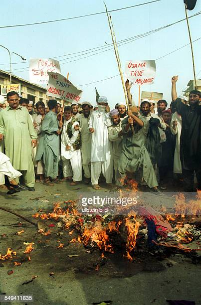 Demontration against the US American politic against Afghanistan in Peshawar Demonstrators burning a Bush puppet at the Khyber Bazaar