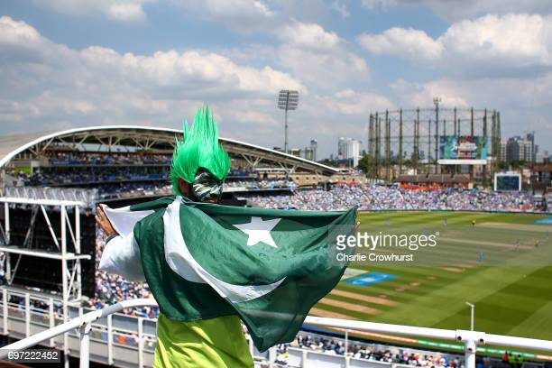 Pakistan fan watches from a near by roof during the ICC Champions Trophy Final match between India and Pakistan at The Kia Oval on June 18 2017 in...
