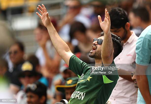Pakistan fans cheer during day five of the First Test match between Australia and Pakistan at The Gabba on December 19 2016 in Brisbane Australia